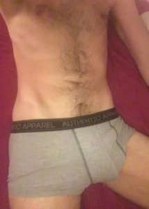 male torso in grey boxers