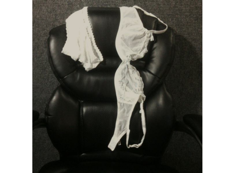 white bra & panties on a black leather chair
