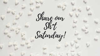 Words 'Share our Shit Saturday' on white confetti background